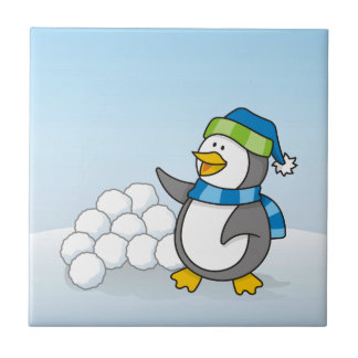 Little penguin with snow balls waving small square tile