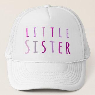 Little sister in pink trucker hat