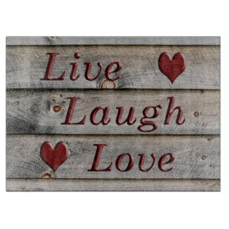 Live Laugh Love on the side of a barn Cutting Board