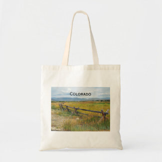 log fence by a prairie tote bag