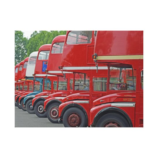 London red buses in a row canvas print