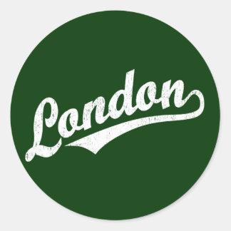 London script logo in white distressed round sticker