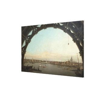 London seen through an arch of Westminster Canvas Print