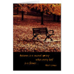 lonely bench in an autumn park greeting card