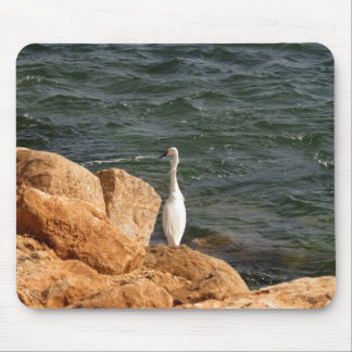 Lonely bird at the ocean mouse pad