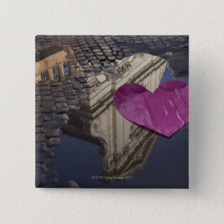 Lonely paper heart floating in a puddle. 15 cm square badge