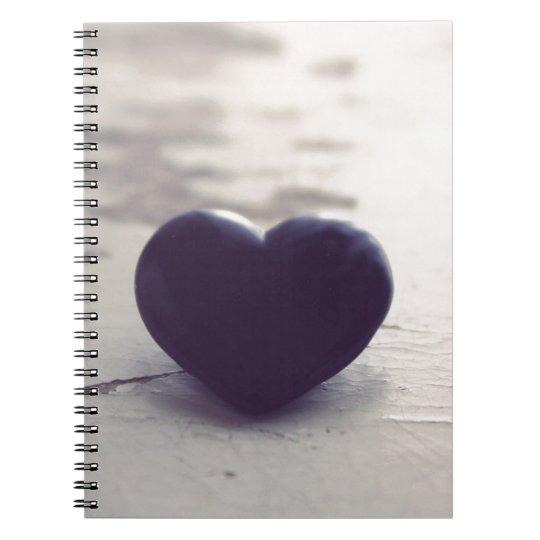 Lonely Purple Stone Heart on a Wet Sandy Beach Notebook