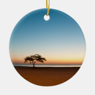 Lonely tree at sunrise in Kuwait Christmas Ornament