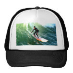 longboard surfer drops with wave hats