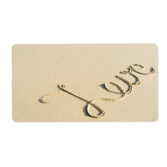 Love carved sign on the beach sand