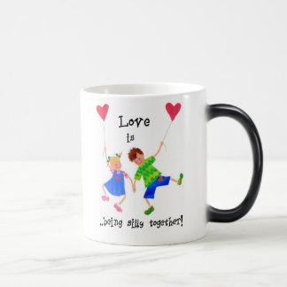 'Love is...' Morphing Mug