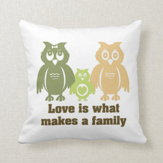 Love is what makes a family. throw pillow