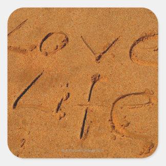 'Love Life' written in Sand Square Sticker