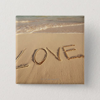 'Love' sand written on the beach with incoming 15 Cm Square Badge