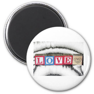 Love Spelled out in Baby Blocks in White Crystal 6 Cm Round Magnet