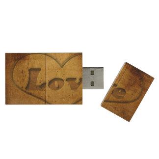Love word written on wood wood USB 2.0 flash drive