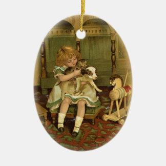 Lovely Child Holding a Kitten Ornament