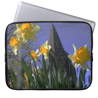 lovely old church with daffodils in foreground laptop sleeve