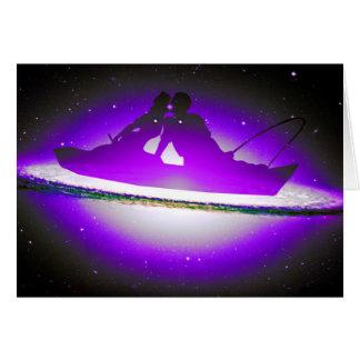 Lovers Kissing and Fishing on a purplish Galaxy. Greeting Card