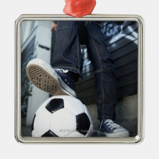 low angle portrait of blond boy with football christmas ornament