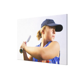 Low angle side view of a softball player looking canvas print