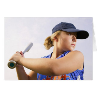 Low angle side view of a softball player looking card