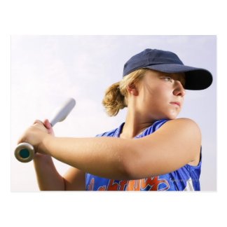 Low angle side view of a softball player looking postcard