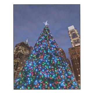 Low angle view at illuminated Christmas tree