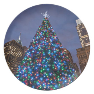 Low angle view at illuminated Christmas tree Plates