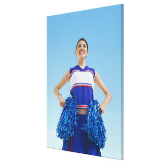 Low angle view of a cheerleader holding her canvas print