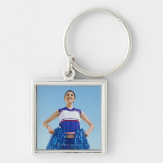 Low angle view of a cheerleader holding her Silver-Colored square key ring