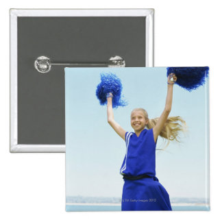low angle view of a cheerleader holding up 15 cm square badge