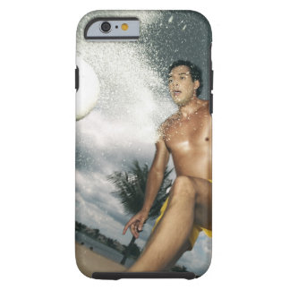 Low angle view of a man playing beach volley tough iPhone 6 case
