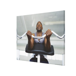 Low angle view of a mid adult man exercising in canvas print