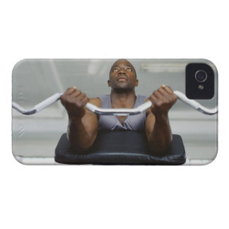 Low angle view of a mid adult man exercising in iPhone 4 case