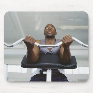 Low angle view of a mid adult man exercising in mouse mat