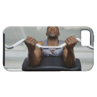 Low angle view of a mid adult man exercising in tough iPhone 5 case