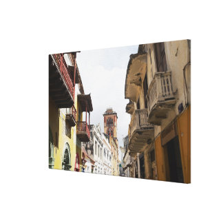 Low angle view of apartments along the street canvas print