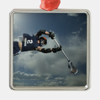 Low angle view of jai-alai player jumping christmas ornament
