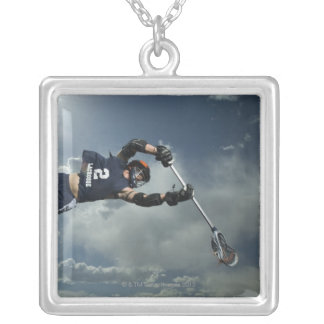 Low angle view of jai-alai player jumping silver plated necklace