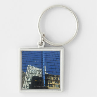 Low angle view of the reflection of buildings on key ring