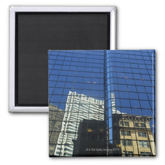 Low angle view of the reflection of buildings on square magnet