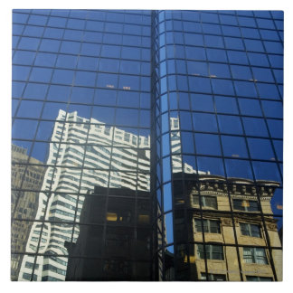 Low angle view of the reflection of buildings on tile