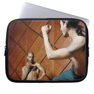 Low angle view of two young men practicing laptop sleeve
