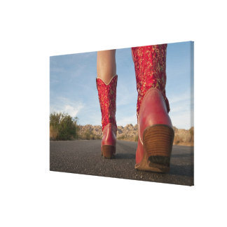 Low-angle view of woman wearing cowboy boots stretched canvas print