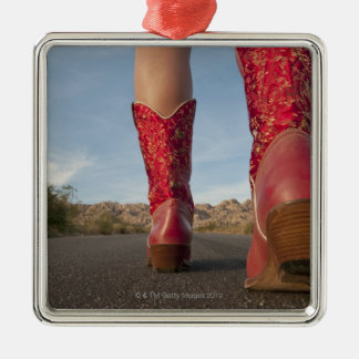 Low-angle view of woman wearing cowboy boots christmas ornament