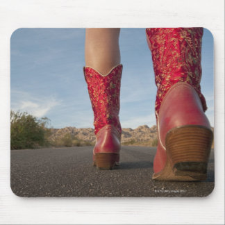 Low-angle view of woman wearing cowboy boots mouse pad