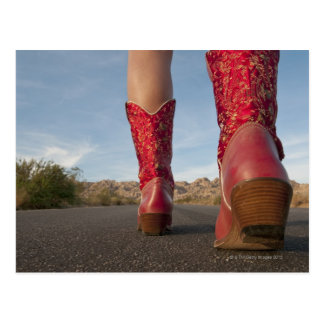 Low-angle view of woman wearing cowboy boots postcard