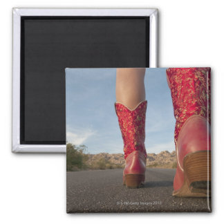 Low-angle view of woman wearing cowboy boots square magnet