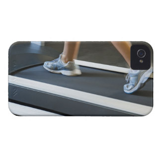 Low section of woman walking on treadmill 2 Case-Mate iPhone 4 cases